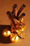 Cinnamon. Brunches of cinnamon with christmas balls stock image
