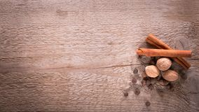 Cinnamon, allspice and nutmeg. Spices on wooden background. Natural and bio ingredients for cooking. Top view and copy space for your text royalty free stock images