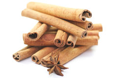 Cinnamon & anise. Cinnamon sticks and anise on white background Royalty Free Stock Image