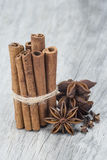 Cinnamon with anise and clove over wood Royalty Free Stock Photo