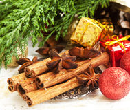Cinnamon and Anise Spices with Christmas Decoration and Fir Tree Royalty Free Stock Photos