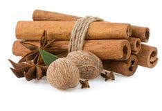 Cinnamon, anise star and nutmeg. Cinnamon sticks, anise star and nutmeg on white background Royalty Free Stock Photography