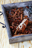 Cinnamon and anise in wooden tray Stock Images