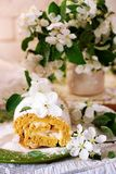 Cinnamon Apple Cake Roll with cream cheese. Style vintage.selective focus Royalty Free Stock Photo