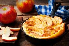 Cinnamon Apple Dutch Baby Pancake in iron pan Royalty Free Stock Image