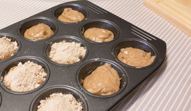 Cinnamon And Apple Muffin Mixture In Patty Tin. Stock Image