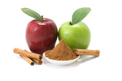 Cinnamon and apples. Two apples, red delicious and granny smith, with cinnamon royalty free stock photo