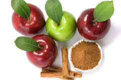 Cinnamon and apples. Four apples and cinnamon over white background stock photo