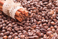 Cinnamon on the background of roasted coffee beans Royalty Free Stock Image