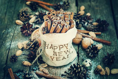 Cinnamon in Bag with Embroidery Happy New Year and Royalty Free Stock Image