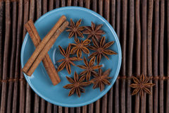 Cinnamon on Blue Plate Stock Photo