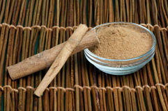 Cinnamon in a bowl Royalty Free Stock Image