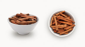 Cinnamon in a bowl. Cinnamon  in a bowl  isolated on a white background Stock Photos