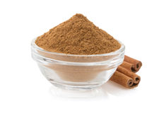 Cinnamon in bowl on white Stock Photography