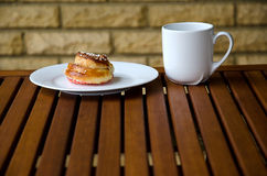 Cinnamon bread with coffee. On a table Royalty Free Stock Images