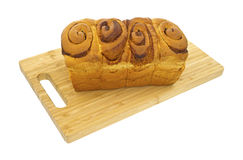 Cinnamon bread loaf on cutting board Stock Photos