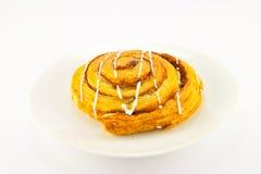 Cinnamon Bun. Single cinnamon bun with clipping path on a white background Royalty Free Stock Photos