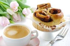 Cinnamon bun with coffee Royalty Free Stock Photo