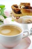 Cinnamon bun with coffee Stock Images