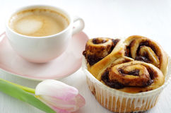 Cinnamon bun with coffee Stock Images