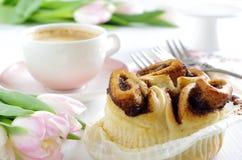 Cinnamon bun with coffee Stock Photo