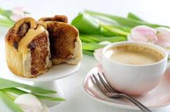 Cinnamon bun with coffee Royalty Free Stock Image