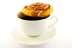 Cinnamon Bun and Cup of Tea. Single cinnamon bun and cup of tea with clipping path on a white background Royalty Free Stock Photo