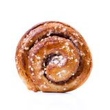 Cinnamon bun isolated on white. One cinnamon roll front Stock Photography