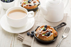 Cinnamon bun for one in a tiny skillet Stock Image