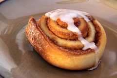 Cinnamon Bun on a Plate Stock Photos