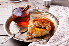Cinnamon bun rolls with syrup and tea Royalty Free Stock Photo
