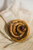 Cinnamon bun with spica Stock Photos