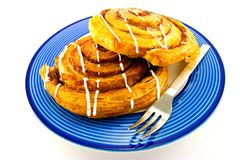 Cinnamon Buns on a Blue Plate Royalty Free Stock Images