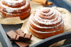 Cinnamon buns with chocolate in the blue tray Royalty Free Stock Photography