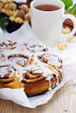 Cinnamon buns with chocolate and cream Royalty Free Stock Images