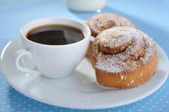 Cinnamon buns and coffee Royalty Free Stock Photos