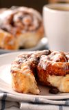 Cinnamon buns with a cup of coffee Stock Image