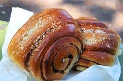 Cinnamon buns. Finnish traditional cinnamon bun called Korvapuusti royalty free stock images