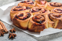 Cinnamon buns with lemon, blueberry and thyme Stock Images