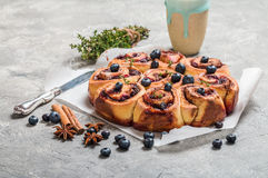 Cinnamon buns with lemon, blueberry and thyme Royalty Free Stock Images
