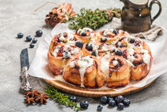 Cinnamon buns with lemon, blueberry and thyme Stock Photos