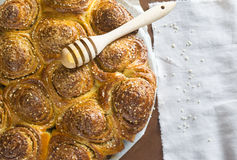 Cinnamon buns with sesame. Lying on the table with napkin Royalty Free Stock Photos