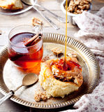 Cinnamon bus rolls with syrup and tea Royalty Free Stock Photography