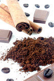 Cinnamon with chocolate and coffee beans Royalty Free Stock Photo