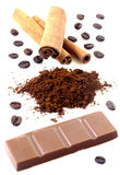Cinnamon with chocolate and coffee beans Stock Photos