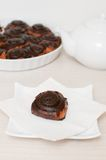 Cinnamon chocolate rolls and tea. Cinnamon rolls with chocolate flavoring and fruit tea Selective focus stock image