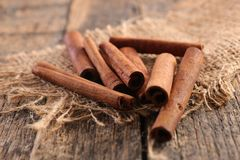 Cinnamon. Close up on cinnamon on wood Royalty Free Stock Photography