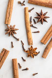 Cinnamon, clove and anise star. Cinnamon, clove and anise star on kitchen table. Top view stock photo