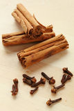 Cinnamon and cloves Royalty Free Stock Images