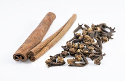 Cinnamon and cloves Stock Images